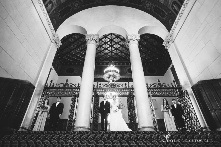 bridal party on stairs The MacArthur weddings formerly legendary-park-plaza-hotel- photographer