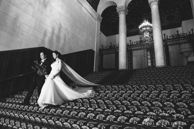 bride groom on stairs The MacArthur weddings formerly legendary-park-plaza-hotel- photographer