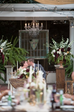 French estate wedding photographer orange reception bride and groom at head table